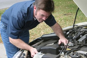 man_working_on_car
