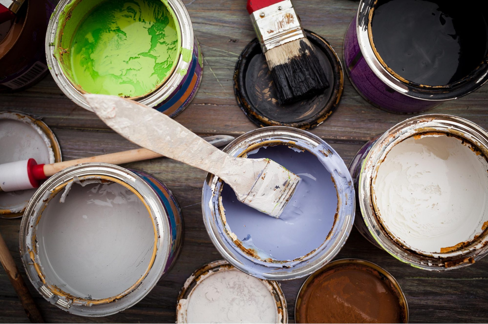 paint cans and paint brushes